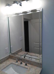 Vanity mirror with beveled edge strips