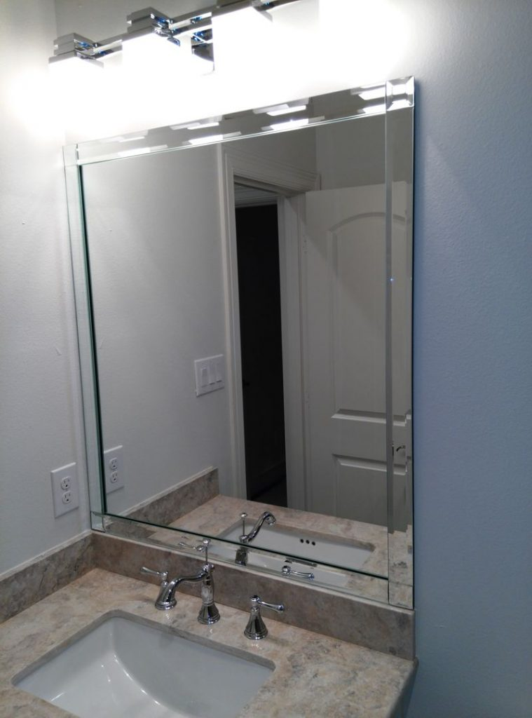 Vanity mirror with beveled edge strips