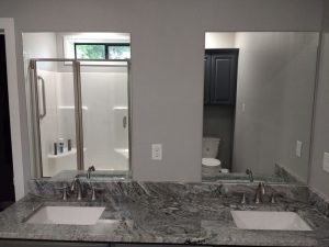 Complete bathroom - vanity mirrors with reflection of new semi-frameless shower enclosure